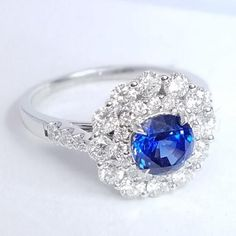 Sky blue hue of this gemstone engagement ring speaks true SEA Wave blue color and we are oh so happy for someone to own this ring soon!  Center sapphire is of 1.26ct weight and is contoured by additional 0.99cts in brilliant diamonds.  Own this ring today and have all the compliments flying your way the moment you slip this ring on.    Center Stone: 1.26ct Round Cut Sapphire Diamonds: 0.99ctw Round Brilliant Cut Diamonds; Quality: F-G color, VS-SI clarity