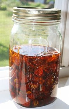 Making your own sun-dried tomatoes is easy. I use cherry tomatoes which I always have an over-abundance of and they give a wonderfully sweet flavor. Cut the cherry tomatoes in half and place them on a clean tarp or screen. Cover them with mesh or other material that permits light but keeps the flies away (last year I used the safety-netting that I saved from our old trampoline!). Leave them in direct sun for a few days until they are rubbery clear to the center but no longer damp – you do…
