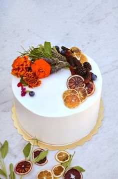 Decorating this beautiful cake for a birthday was SO easy! We used California Lemon and Blood Orange Crisps along with mulberry, lavender, edible flowers, rosemary, and blueberries. It's a super easy DIY cake project that you can apply to cupcakes too for your next party!
