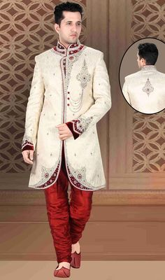 Adds a sign of splendor statement for the look wearing this butter cream embroidered brocade men's sherwani. The ethnic moti, resham, stones and velvet patch work to your attire adds a sign of elegance statement for your look. Brocade might vary from actual image. #DhupionJariStripeMenSherwani
