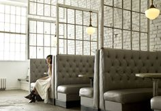 Mickie Spencer - Austin Restaurant Designer. Banquette seating on the external wall side of the dining table.