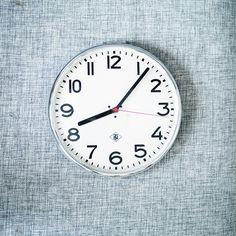 Arne Jacobsen clock on an AMAZING textured wall. LOVE.