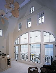 It may not be warm enough to go out on the deck quite yet, but these beautiful bay windows bring the scenery inside! #HomeDesignTips