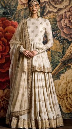 Cream Lehenga with booti printed work and a long simple blouse. Pairing the two together makes the outfit look like an Anarkali. Indian Gowns Dresses, Indian Fashion Dresses, Dress Indian Style, Indian Designer Outfits, Eid Dresses, Indian Bridal Outfits, Pakistani Bridal Dresses, Pakistani Outfits, Bridal Anarkali Suits