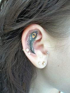 Peacock Feather Ear Tattoo. (Tattooed by Larry Farley in Michigan)