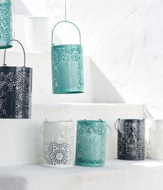 Candle holder in painted metal with a perforated pattern. | H&M Home