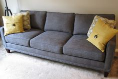 """is the Townsend 3 cushion sofa by Rowe. On the receipt it says model number K620K-000 - that's for the sofa model - then it has the following """"TP: Q-10170-33"""" and then """"R23721-10"""". One of those codes represents the gray and yellow diamond print cushion fabric (it came with two pillows in an accent fabric of your choosing) and the other code represents the gray sofa fabric, but I'm not certain which designates which. The finish of the wood legs on my sofa is """"chestnut""""."""