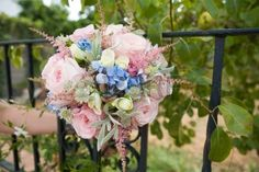 Wedding bouquet of pink and white roses and blue fresia on a garden Stock Photo