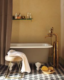 Create a romantic, luxurious mood in a bathroom with just a few brass touches -- like this striking exposed tub filler, which combines old-world elegance with modern craftsmanship. Since the minerals found in tap water can spot unlacquered brass, be sure to wipe away droplets with a soft cloth.