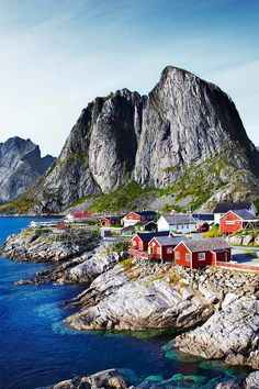 Fishermen's huts (rorbuer) are perched by the sea in the village of Reine in the Lofoten Islands, off Norway's west coast. Huts like these were first built here in the 12th century // photo by Matt Munro