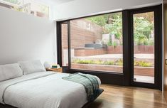 San Francisco master bedroom with a glass wall and a clerestory window / Cary Bernstein Architect