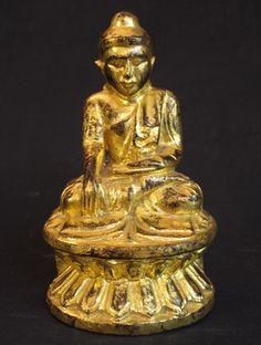 Antique Burmese Buddha [Material: Wood] [24,5 cm high] [19th century] [Mandalay style] [Bhumisparsha Mudra] [Goldplated with 24 krt. gold] [Originating from Burma] [Price: 325 euro]