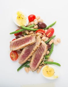 This quick and easy modern take on a tuna niçoise salad is the perfect weeknight dinner. White beans and a light vinaigrette are paired with seared tuna. Tuna Recipes, Salad Recipes, Healthy Recipes, Tuna Nicoise Salad, Sushi Grade Tuna, Lemon Green Beans, Seared Tuna, Tuna Steaks, Great Northern Beans