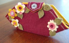 flower needle case - unusual shape/construction, and I like the flowers on this one