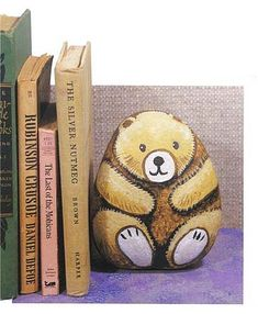 Tons of AMAZING ideas to use stones, eg this cute bear book holder.