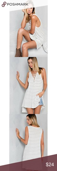 👉2-LARGE ONLY👈Striped Lace Up with Side Slits Flirtatious and adorable lace up rib with front tie deep v-neck top. Hi-low hem with side slits.  Match with pair of shorts or mini skirt.       Color - Off White/H.Grey.      96%Rayon/4%Spandex.   Size-Medium & Large ONLY.    Made in USA🇺🇸 Classic Paper Doll Tops Tunics
