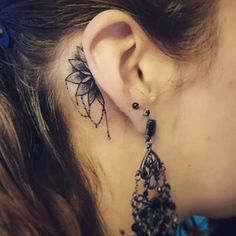 Outstanding Ear Ornament Tattoo