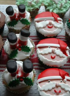 Funny and adorable looking Christmas cupcakes. The cupcake designs feature Santa in cute ways such as his big smiling face as well as an upside down Santa who trips on a mistletoe with his feet sticking up in the air.