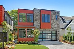 Colorful exterior features make this new construction in Kirkland, WA unique