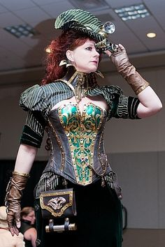 Sooo....this is glorious. From the corset, to the gloves, to the hat...very piratey but very steampunk. Oh how I wish I wish I wish it were socially acceptable to dress like this on a regular daily basis XD