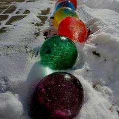 Frozen water balloons with food colouring. Once froze take off the balloon
