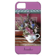"iPhone 5c Case Teapot with Flowers Radiant Orchid - I love the old fashioned mood of these flowers in a vintage teapot vase. I also adore the colors and the mismatched patterns in the fabrics, with a trendy shabby chic feel. This iPhone case sports a ""radiant orchid"" background. Trendy Radiant Orchid was recently selected as Pantone Color of the Year for 2014. Original photograph by Marcia Socolik. All Rights Reserved © 2013 A&M Socolik. #iPhone #Vintage #ShabbyChic #Purple #RadiantOrchid"