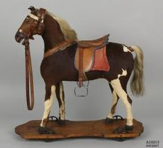 A10213 Toy horse, pull along, wood / leather / metal / [calf skin] / [cow's tail hair], probably manufactured in Germany, 1875-1899 - Powerhouse Museum Collection