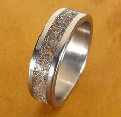 Surprisingly intrigued by this. Titanium Wedding RingThe Junk Ring by RobandLean on Etsy, $145.00