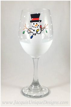 Enjoy this Snowman with Christmas Lights Hand painted wine glass for your holiday season! This glass can be used as decoration, a fun addition to a cocktail party, a gift for a loved one or a stylish glass! Please enjoy this glass painted both stemless or with a stem. In the drop