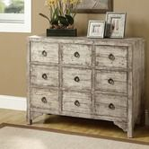 Two of these side by side might work under the window. Found it at Wayfair - 9 Drawer Accent Dresser
