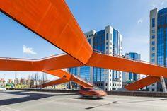 maximina almeida + telmo cruz overlap orange steel bridge above highway in lisbon