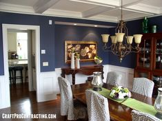 Formal Dining Room painted Van Deusen Blue above White wainscoting in Morristown NJ by CraftPro Contracting Interior Painting