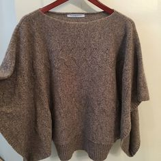 NWOT LILLY MCNEIL CROPPED CABLE KNIT BEIGE SWEAT♏️ NWOT LILY MCNIEL CROPPED SWEATER, SEEN ON LAUREN CONRAD, JESSICA SIMPSON.. And MORE.. ITS FLATTERING AND COMFORTABLE! SLIMMING CUT! FAINT HORIZONTAL CABLE KNIT PRINT.. BECAUSE HARD TO EXPLAIN FIT.. SEE EXAMPLE OF ME WEARING! RETAIL PRICE @290$ Lily Mcneal Sweaters