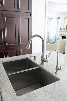Moen's Arbor One-Handle Kitchen Faucet, dark maple kitchen cabinets, Kashmir White Granite Countertop