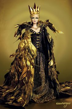 https://flic.kr/p/GpX8bk | The Huntsman Winter's War: Ravenna OOAK doll | From the upcoming movie The Hunstman Winter's War comes Ravenna the Evil Queen.  Ready for the takeover of the kingdom through the magic mirror, she's a wicked vision of golden opulence. Wearing a re-creation of the costume seen in the movie designed by three times Academy Award Collen Atwood, this devourer of souls  played by talented Charlize Theron is as power hungry as she is evil.  Iconic collar feathered cape…