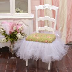 Sit pretty in this lovely white ladder back chair. Features a sage and pink fabric on the seat adorned with a rose design and a charming white tutu skirt. From The Bella Cottage