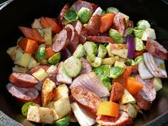 Roasted Apple, Vegetable and Kielbasa Bake, made in a 12 inch dutch oven. From Everyday Dutch Oven.
