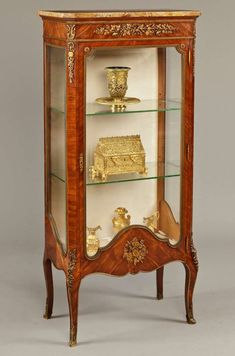 A fine vitrine in the manner of Francois Linke Constructed in kingwood, with gilt bronze mounts, in the Louis XVI Transitional style; rising from bronze foliate sabots, with gently swept cabriole legs capped with bronze espagnolettes; the single Painting Wooden Furniture, Fine Furniture, Rustic Furniture, Vintage Furniture, Modern Furniture, Outdoor Furniture, Victorian Furniture, Furniture Storage, Classic Furniture