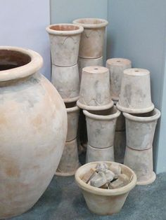 get a kiln and DIY!  Classic terra cotta containers from Italian Terrace spotted at Architectural Digest Home Show
