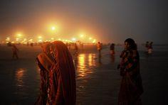 20 Photos: Hindu pilgrims walk back to camp after prayers at Gangasagar island Hindu India, Around The Worlds, Spirituality, Pilgrims, Culture, Island, Concert, Prayers, Photography