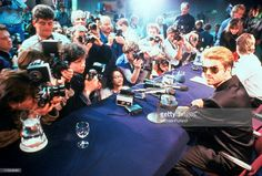 George Michael, appearing in front of photographers at a press conference, Japan, March 1988.