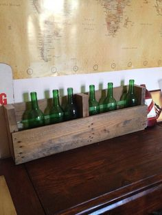 Simple project made from reclaimed pallets. wine bottle holder or would be great for magazines.