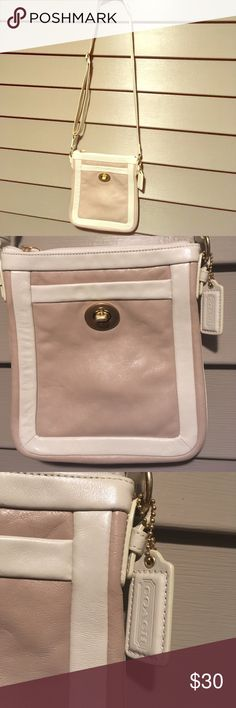Coach Leather Crossover Handbag Tan Very nice authentic Coach tan and off white leather cross over style handbag with adjustable strap, inside lined in light purple satin. One outside pocket. Coach Bags Crossbody Bags