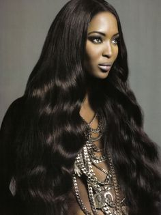 """Naomi Campbell.  Rocking 30"""" in Natural Wavy.  Thinking of pulling this look off this summer, call SaShi.   We carry lengths all the way to 40"""" straight from the temple in India.  Got to love it!!"""