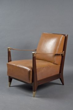 """Single Armchair  France, Art Moderne, 1950s Mahogany frame with a slatted back, upholstered seat, and armrests composed of leather straps held in gilt bronze hardware; raised on four tapered leg the sabots on the front two. Seat Height: 17"""" Arm Height: 24-1/2"""" Height: 32-1/4"""" Width: 25-1/4"""" Depth: 32-1/4"""" Code : N-7282"""