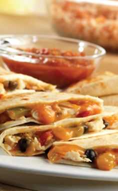 Prepare this quick easy favorite in minutes. Nothing says yum like some Chicken and Black Bean Quesadillas.