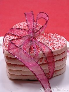 Heart shaped sugar cookies stacked and tied with ribbon. great as a baby shower party favor