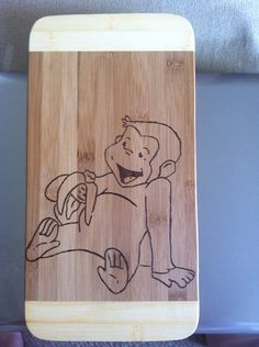 Curious George cutting board  on Etsy, $15.04 AUD