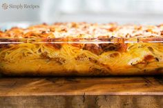 Baked Spaghetti ~ Casserole of thin spaghetti pasta, sausage, mushroom, and tomato sauce, ricotta, Parmesan, and Mozzarella cheeses. ~ SimplyRecipes.com