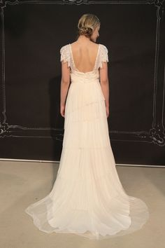 Flutter sleeve wedding dress with low back from Ivy & Aster
